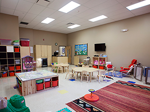 Tables, rugs, and cubbies for daycare