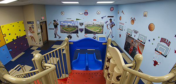 Indoor playground with wall of sports