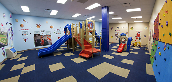 Daycare playground with indoor rock climbing wall
