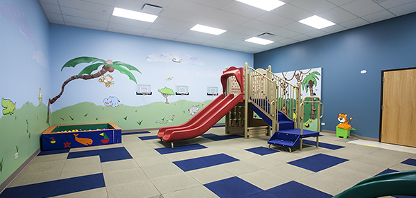 Indoor playground with murals on walls