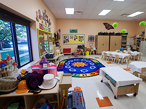 Daycare room with round rug