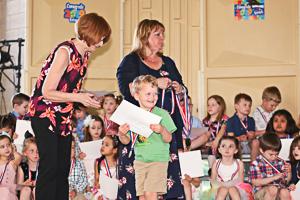 Receiving preschool diploma