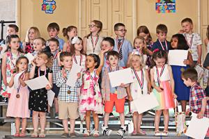 Kids who graduated preschool in crowd