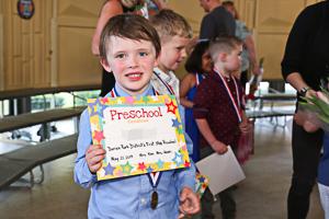 Preschool graduate with diploma