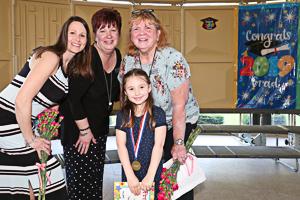 Happy people at preschool graduation