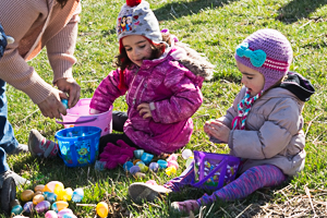 Kids counting Easter eggs