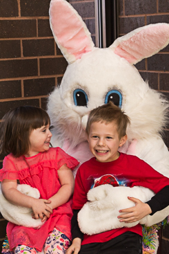 Kids posing with the Easter bunny