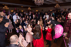 Crowded father daughter dance