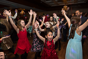 Daughters dancing with arms up