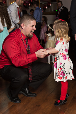 Happy father and daughter dancing