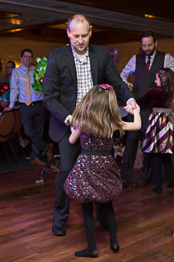Dancing daughter and father