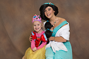 Two happy girls posing for photo at the pageant