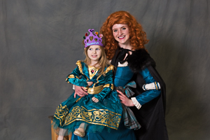 Two girls smiling for a photo in their dresses