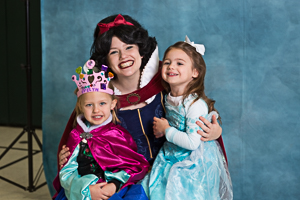 Girls smiling for photo with princess