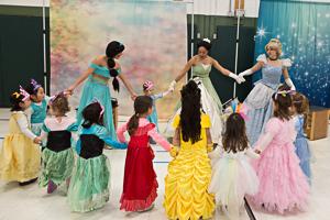 Kids watching princesses dance