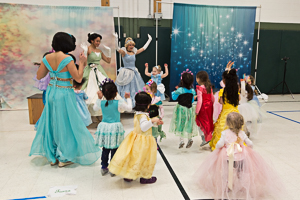 Kids dancing with princesses at event