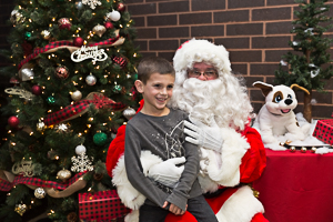 Boy posing with Santa for a photo
