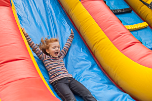 Sliding at bouncy house