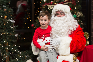 Santa hanging out with boy