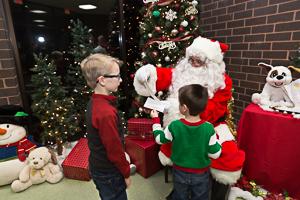 Santa talking to kids