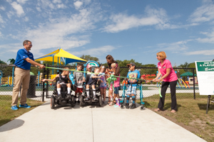 Cutting the ribbon at the playground