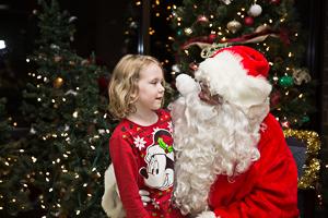 Child talking to Santa