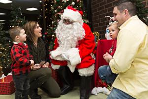 Family visiting Santa