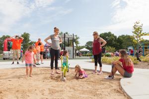 Kids playing in sandbox at playground