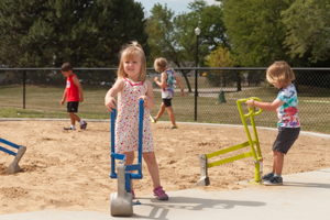 Children playing with digging toy at the playground