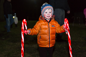 Child with large candy canes