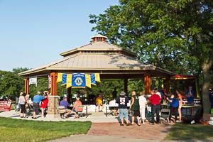 Crowd of people gathered around pavilion