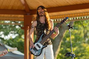 Guitar player at park concert