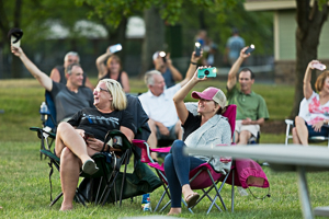 Adults enjoying concert in the park