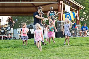 Kids enjoying park concert