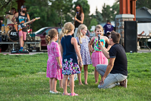 Kids speaking into microphone at concert