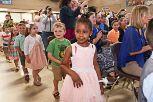 Preschool graduates entering ceremony