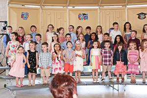 Happy preschool graduates posing for a photo