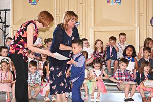 Kids at preschool graduation